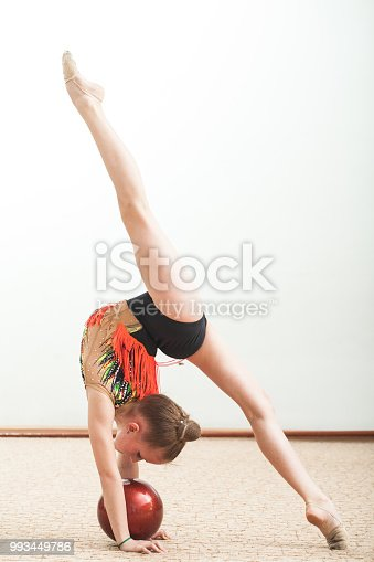 exercise rhythmic gymnastics, girl with ball on white background