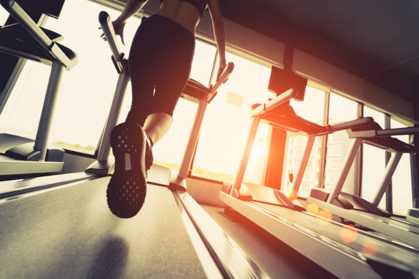 exercise treadmill cardio running workout at fitness gym of woman taking weight loss with machine aerobic for slim and firm healthy in the morning. - gmail imagens e fotografias de stock
