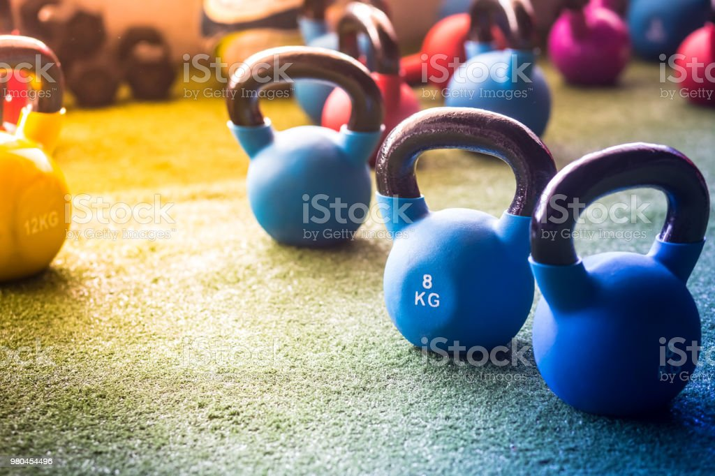 exercise With colorful dumbbell. stock photo