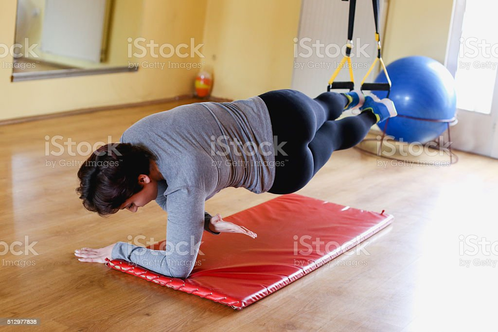 Exercise with hanging fitness belt stock photo