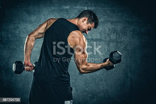 Athletic Men Exercise With Weights