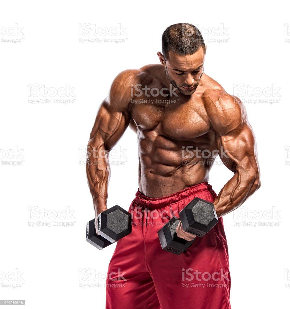 Exercice avec les poids et haltères  - Photo