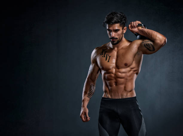 Exercise with Weights Handsome Muscular Men Exercise with weights abdominal muscle stock pictures, royalty-free photos & images