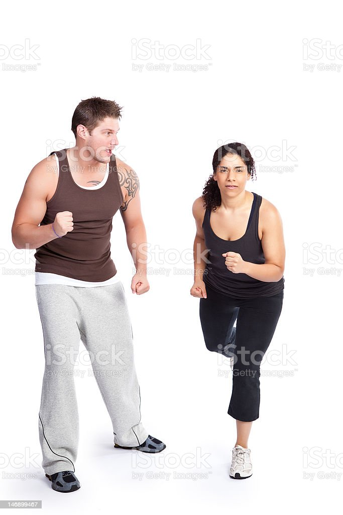 Exercise woman with trainer royalty-free stock photo
