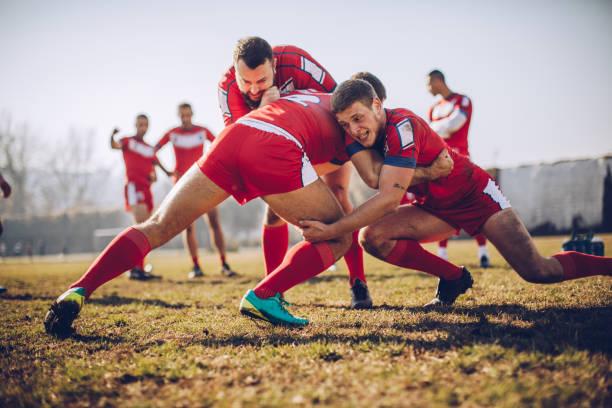 ejercicios antes de juego - rugby fotografías e imágenes de stock