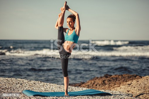 816941230istockphoto Exercising at the beach 586061878