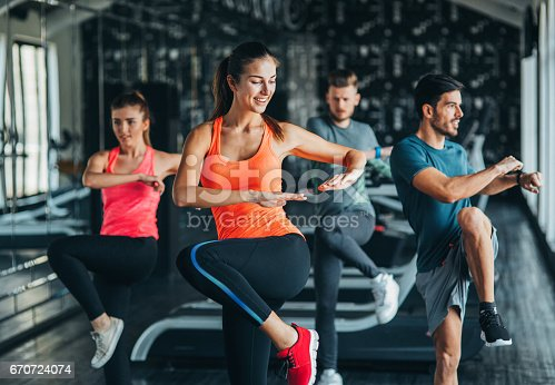 istock Exercising at the gym 670724074