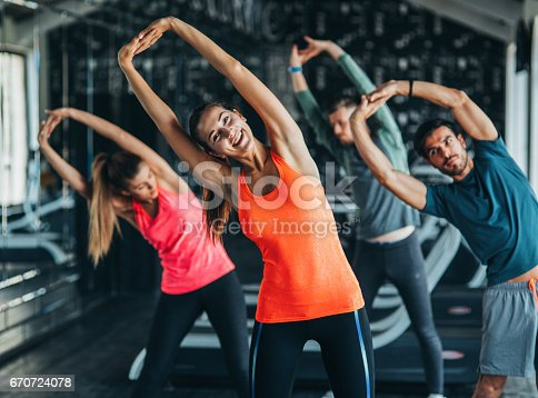 istock Exercising at the gym 670724078