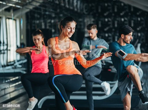 istock Exercising at the gym 673884508