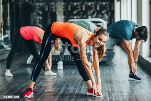 istock Exercising at the gym 680886458