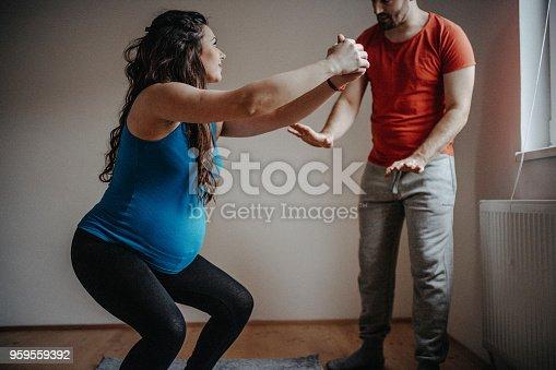 916126642 istock photo Exercising beautiful pregnant woman at home 959559392