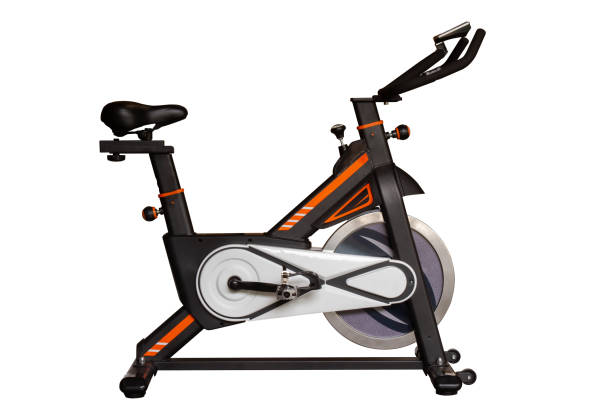 exercising bike for exercise in gym or fitness isolated on white background. exercising bike for exercise in gym or fitness isolated on white background with clipping path. exercise bike stock pictures, royalty-free photos & images