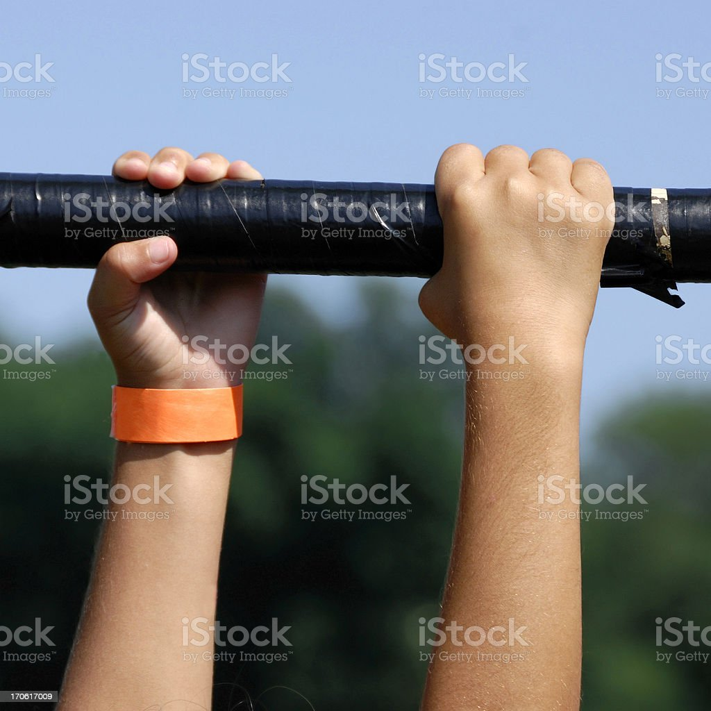 Exercising Child:Hands Grasping & Hanging On stock photo