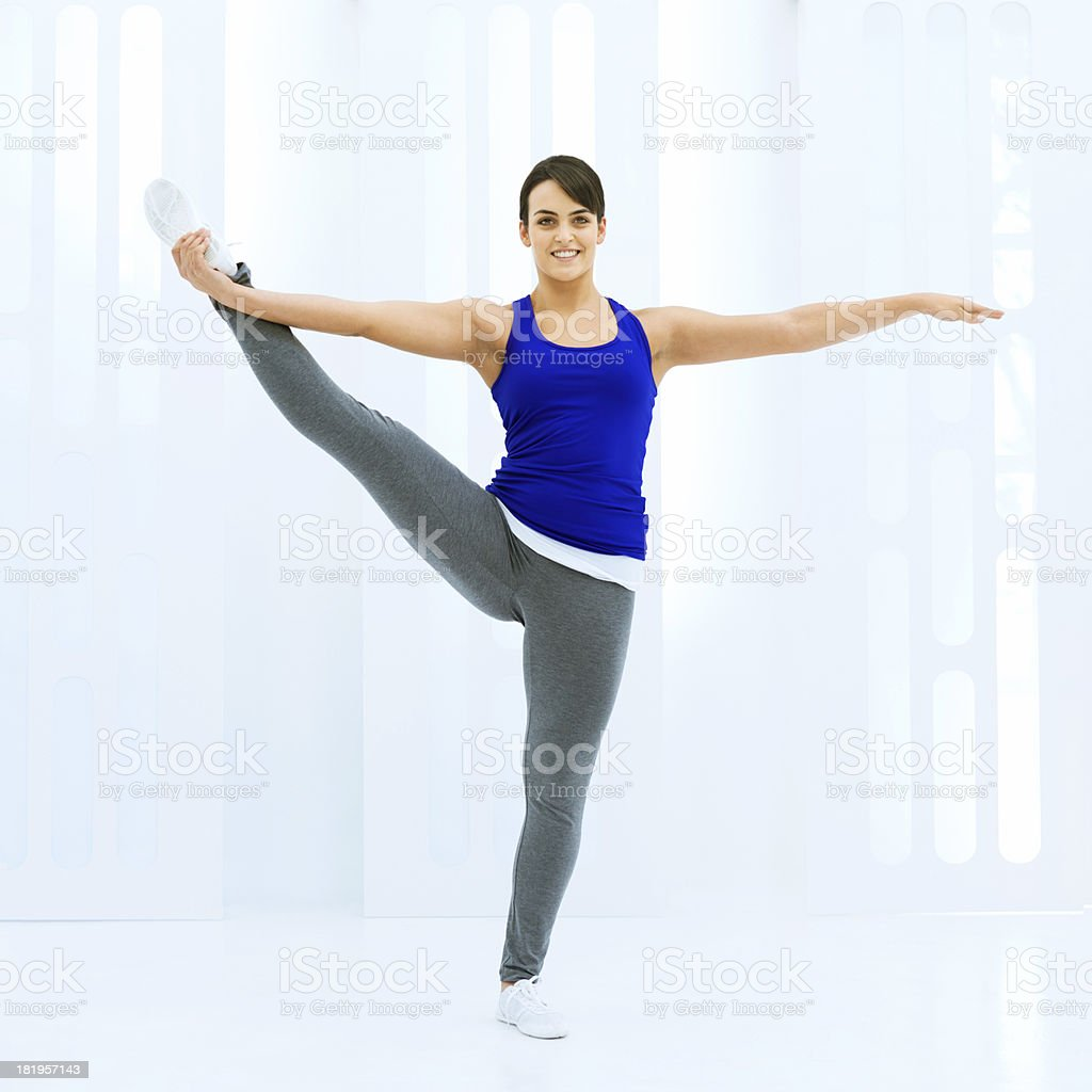 Exercising in a white gym royalty-free stock photo