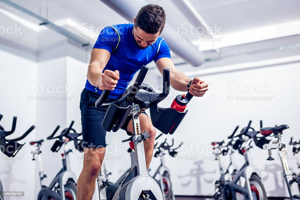 Spinning Instructor at Gym stock photo