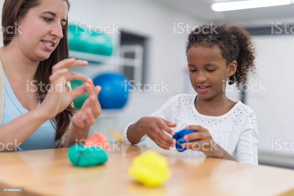 Exercising kids in physical therapy clinic stock photo
