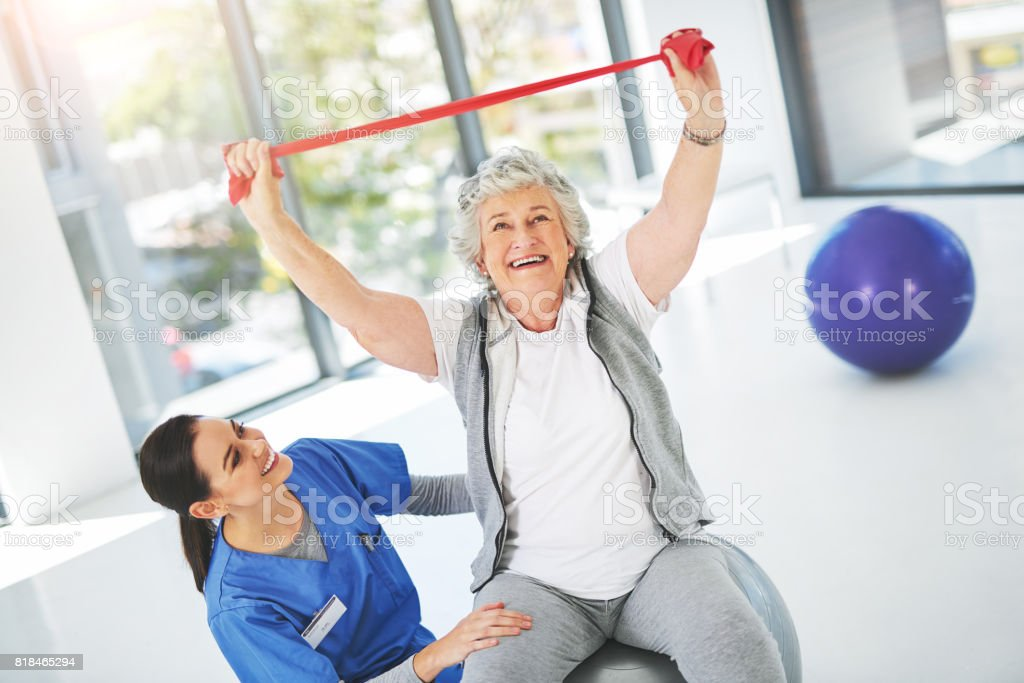 Exercising makes her feel young again stock photo