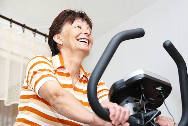exercising mature woman stock photo