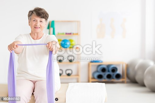 950649706istockphoto Exercising old woman at gym 960844152
