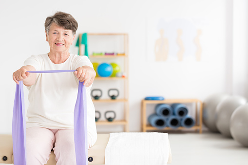 950649706 istock photo Exercising old woman at gym 960844152