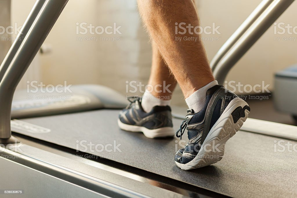 Exercising on treadmill. stock photo