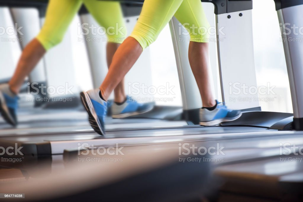 Exercising on treadmill royalty-free stock photo