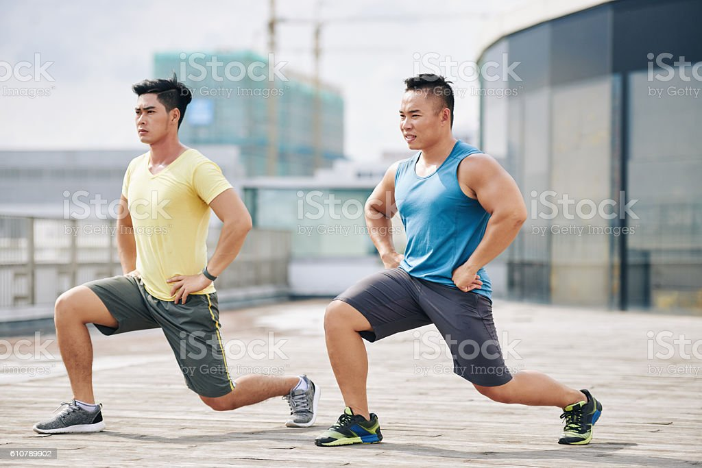 Exercising sporty men stock photo