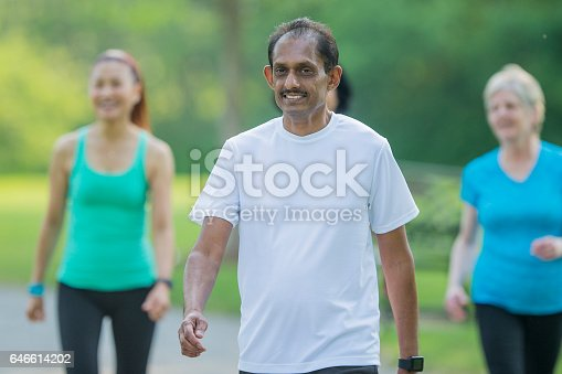 646614234 istock photo Exercising Together Outdoors 646614202
