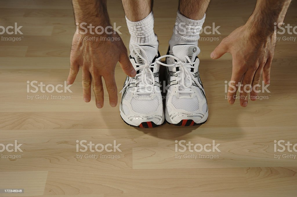 exercising trainers on wooden floor stock photo