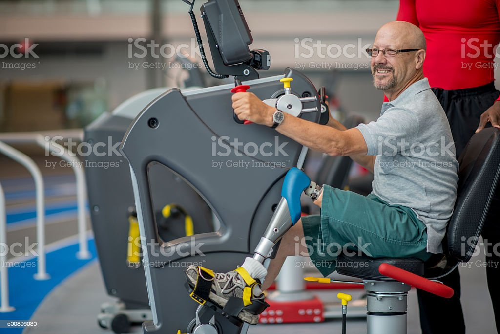 Exercising with a Prosthetic Leg at the Gym stock photo