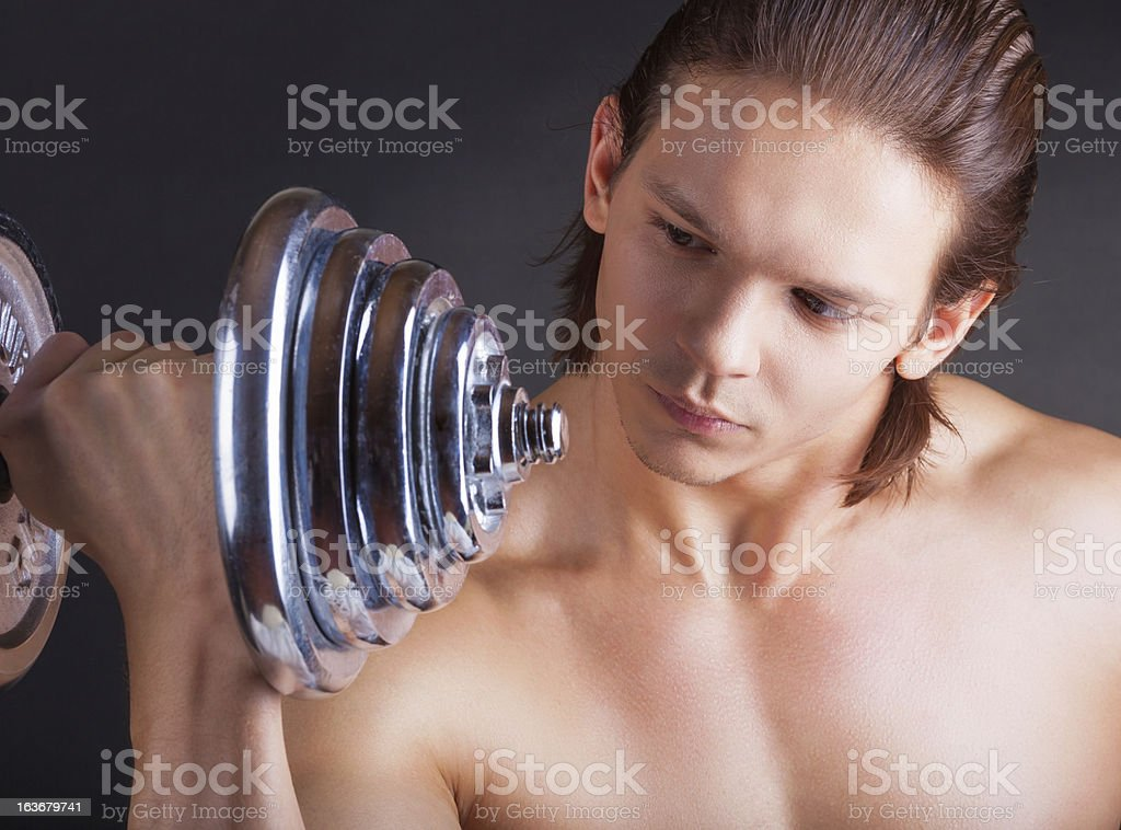 Exercising with dumbbell royalty-free stock photo