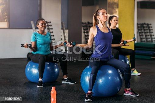 1195045259istockphoto Exercising With Dumbbells 1195045032