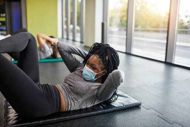 Exercising With Face Mask In The Gym - Reopening Business stock photo