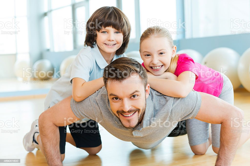 Exercising with father. stock photo