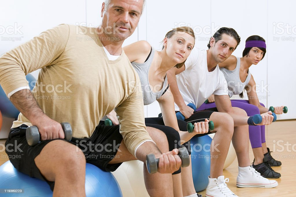 Exercising with fitness ball at gym royalty-free stock photo