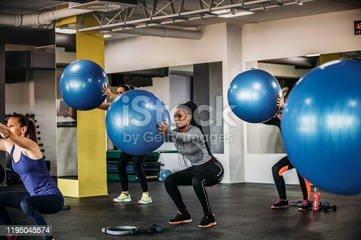 1195045259istockphoto Exercising With Fitness Ball 1195045574