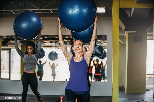 1195045259istockphoto Exercising With Fitness Ball 1195046206