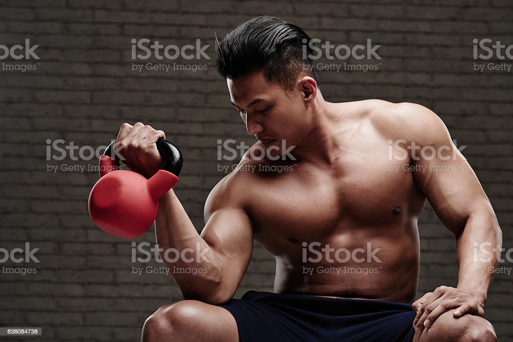 Exercising with kettlebell stock photo