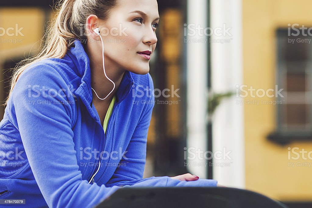 Exercising woman outdoors stock photo