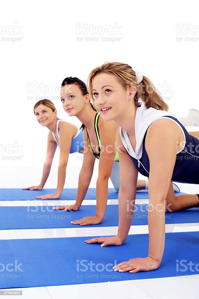 Exercising women looking upwards. royalty-free stock photo
