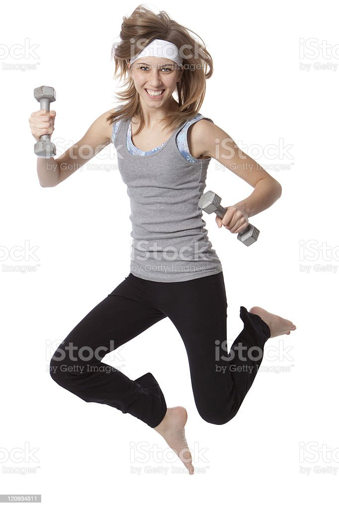 Exercising Young Woman Holding Weights Jumping Isolated on White royalty-free stock photo