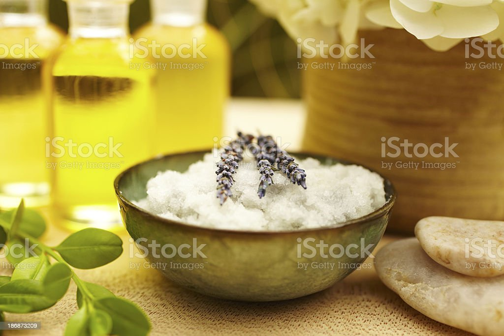 Exfoliation salt scrub at spa with lavender royalty-free stock photo