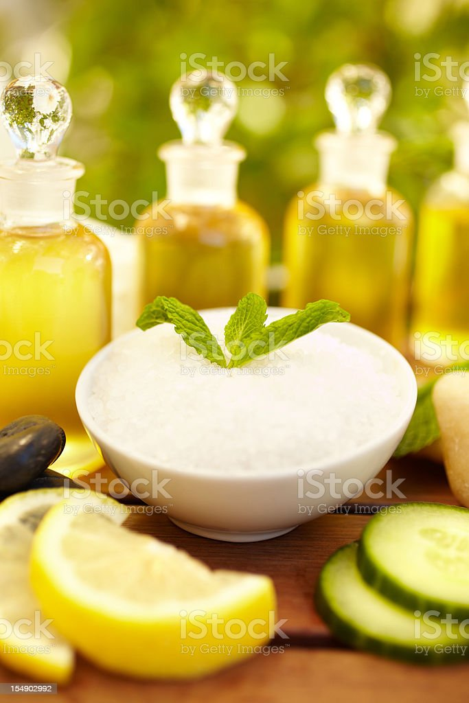 Exfoliation salt scrub at spa with mint and oil royalty-free stock photo