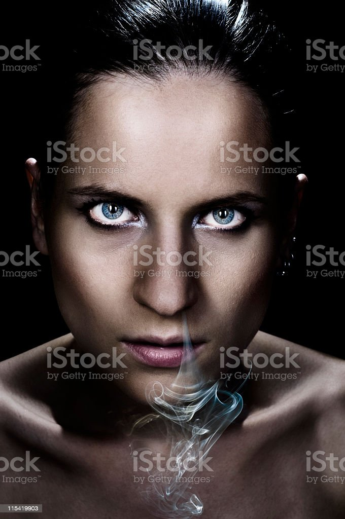 exhaling smoke stock photo