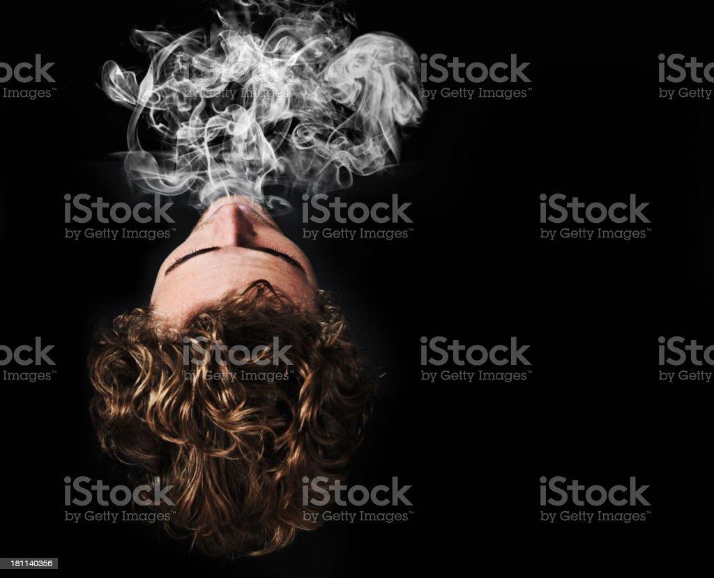 Exhaling the smoke stock photo