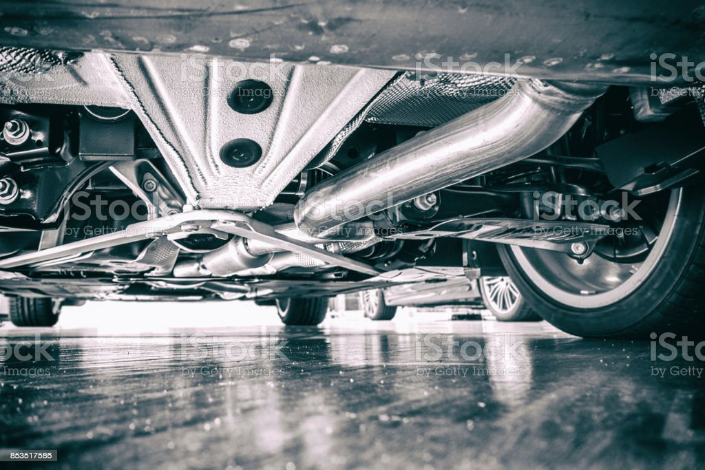 Exhaust pipe and technik - view under the car stock photo