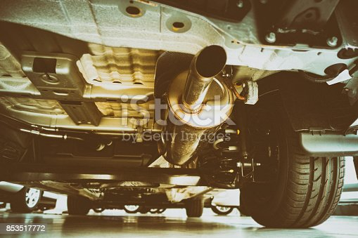 853517784 istock photo Exhaust pipe and technik - view under the car 853517772