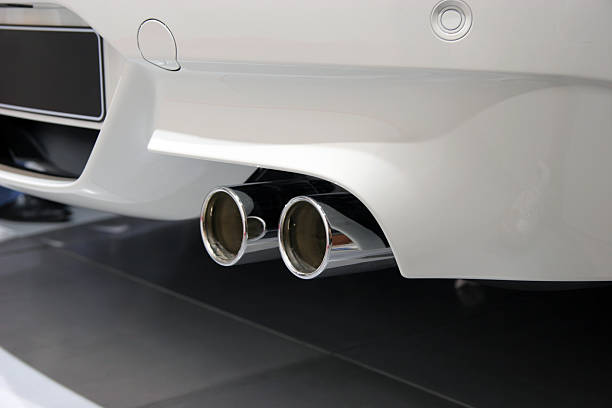 Exhaust pipe of white sports car stock photo