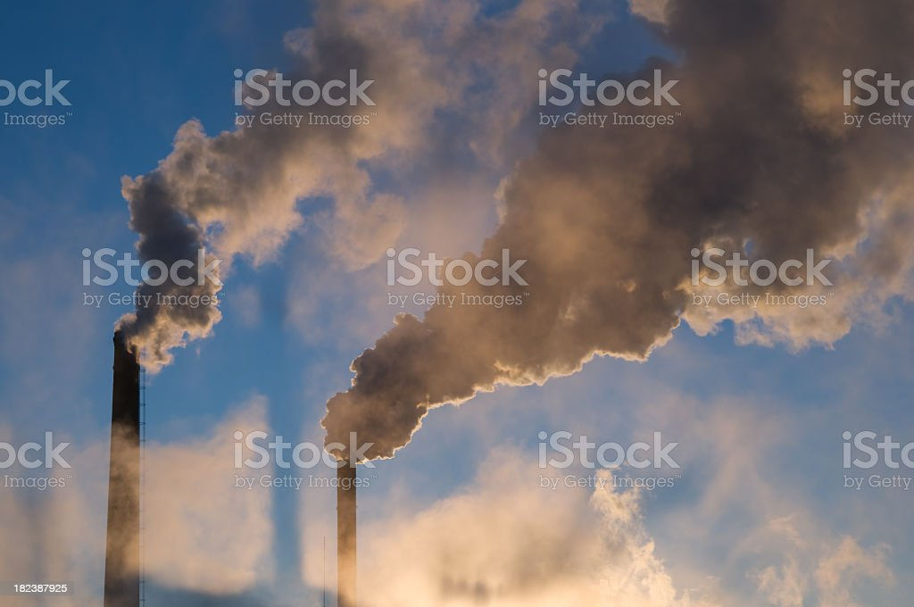 Exhaust smoke polluting clean air royalty-free stock photo