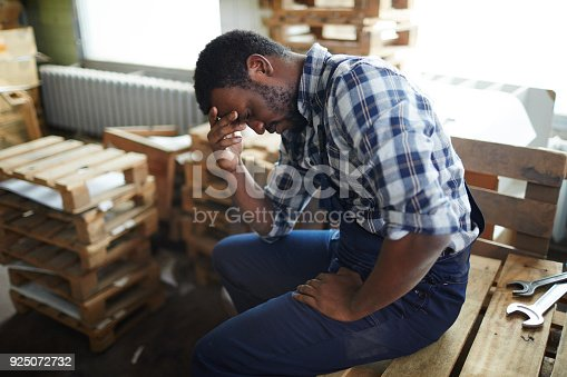 1001622522 istock photo Exhausted African employee in warehouse 925072732